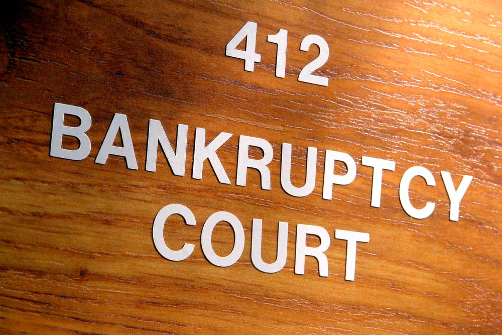 "Wooden surface with the wording ""412 Bankruptcy Court"""