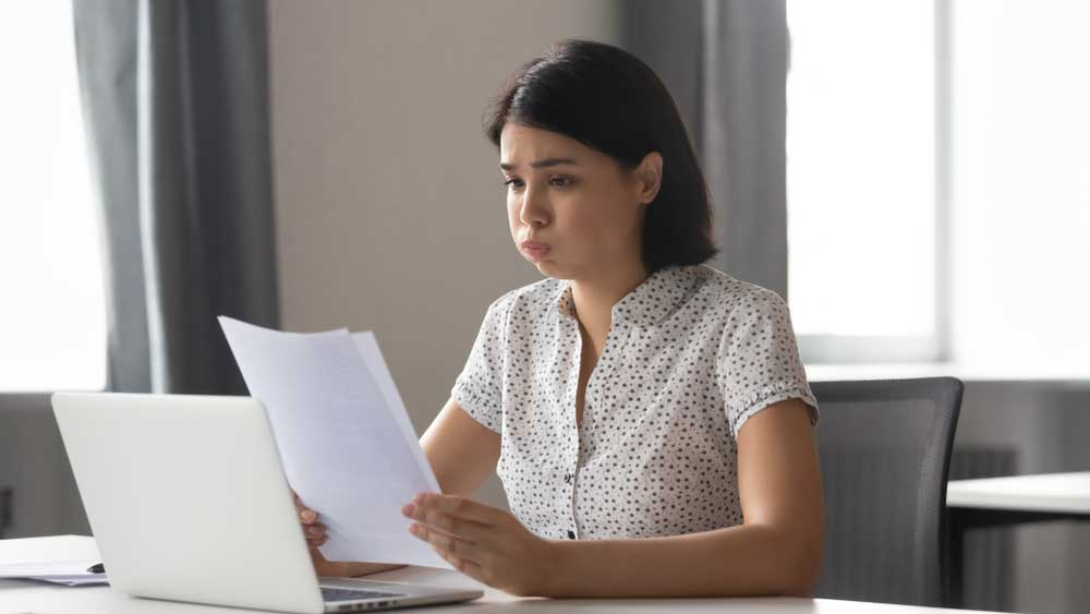 Woman looking at her bankruptcy report