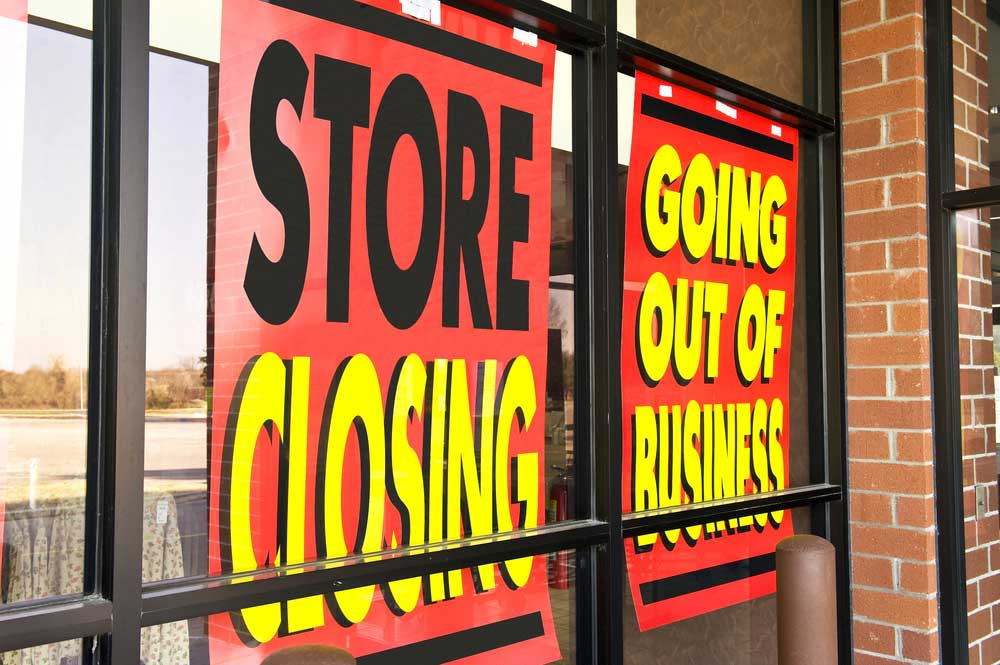 "Store front with sign saying ""Store closing - going out of business"""