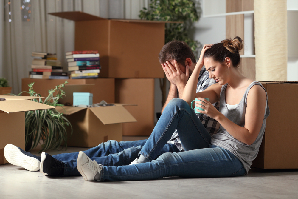 Bankrupted couple packing their belonging in boxes